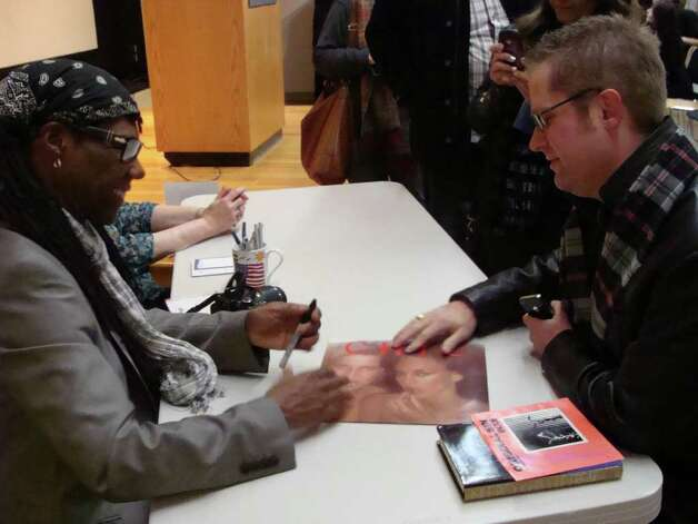 Ben Gott of Fairfield had Nile Rodgers autograph his first album with the band Chic during his appearance Monday at the Westport Public Library. Photo: Meg Barone / Westport News freelance
