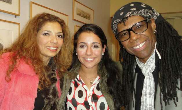 Nile Rodgers poses with two fans, mother and daughter Sholeh Janat, left, and Nicolette Weinbaum, 17, a senior at Staples High School during his Monday night appearance at the Westport Public Library. Photo: Meg Barone / Westport News freelance