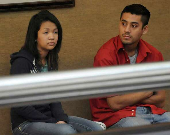 Cindy Le, left, Mandy Le's sister, sits outside the courtroom Monday morning. The punishment phase of Jonathan Edward Benitez, who was convicted of manslaughter Friday in Judge John Stevens' Criminal District Court, started Monday. Prosecutors are expected to present evidence in the sentencing phase that says he was arrested for aggravated assault months prior to the wreck that caused Mandy Le's decapitation death. He faces up to 20 years in prison.   Dave Ryan/The Enterprise Photo: Dave Ryan