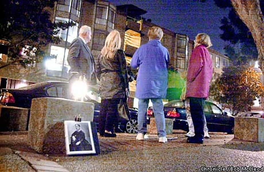 WBGHOSTc -C-09OCT01-SF-BM  Jim Fassbinder leads a gorup on his ghost tour of SF. here they are near the corner of Octavia and Bush, where something spooky happened 100 years ago.  CHRONICLE PHOTOS BY BOB MCLEOD Photo: BOB MCLEOD