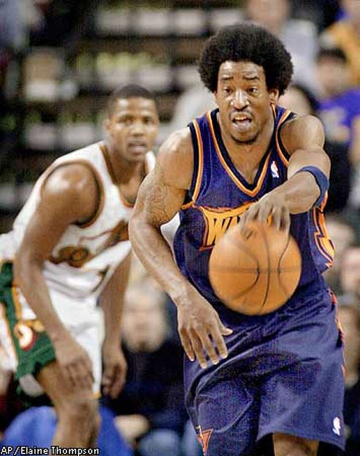 FILE--Golden State Warriors' Chris Porter, right, drives up court as Seattle SuperSonics' Emanual Davis watches in this Dec. 3, 2000 photo in Seattle. The Charlotte Hornets traded forward Derrick Coleman to the Philadelphia 76ers on Thursday Oct. 25, 2001, in a three-team trade involving the Golden State Warriors. The Hornets get forwards George Lynch, Robert Traylor and Jerome Moiso from Philadelphia and forward Chris Porter from Golden State. The Warriors get forwards Cedric Henderson and a conditional first round draft pick in 2005 from Philadelphia, as well as cash from Charlotte. (AP Photo/Elaine Thompson) Photo: ELAINE THOMPSON