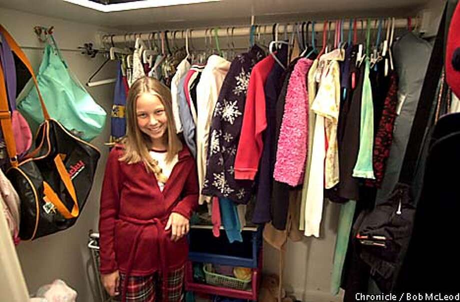 KIDS28c-C-16OCT01-LV-BM  Emily Arbuckle in her closet with her various outfits in her room in San Francisco.  CHRONICLE PHOTOS BY BOB MCLEOD Photo: BOB MCLEOD