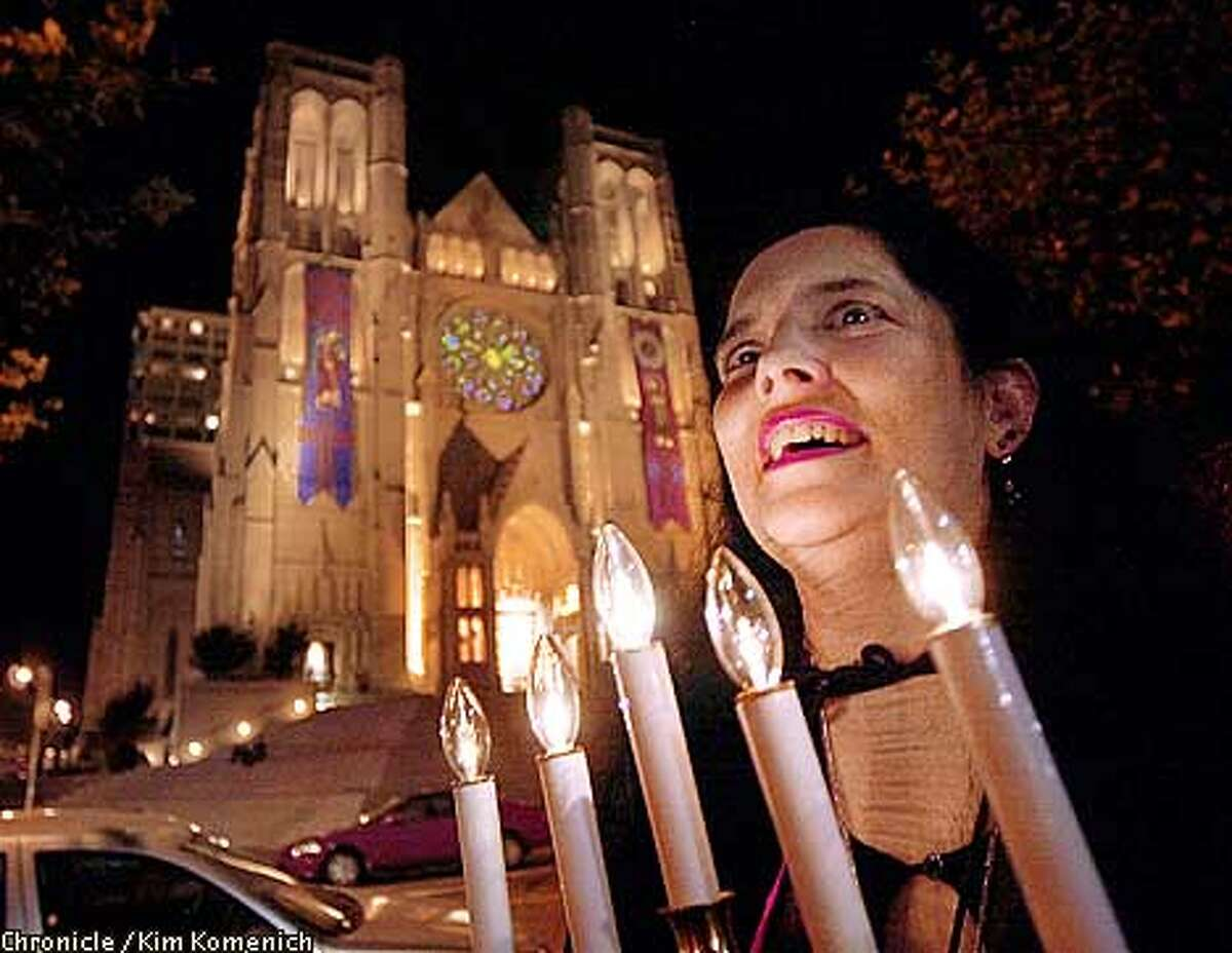 Kitty Burns, a.k.a. Vampiress Mina, leads vampire tours from atop Nob Hill on Saturday nights. That's Grace Cathedral in the background. CHRONICLE PHOTO BY KIM KOMENICH