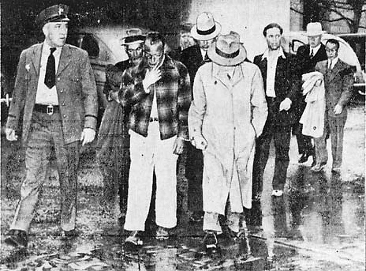 Photo from the February 23, 1942 San Jose News of John Perata, 42, third from left in plaid jacket, and Felix Bersano, 44, center in trench coat and hat, both from the San Jose/Campbell area, being led to the county jail. Perata and Bersano are the father and uncle, respectively, of Don Perata of Saratoga. Handout photo.