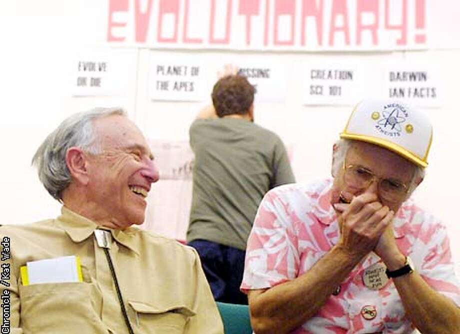 While co-organizer of the Darwin Party Dave Fitzgerald, (CENTER)of San Francisco sets up an Atheist version of Jeoparday, atheist club member (L to R) Harold Weingarten, of Alameda laughs as he listens to another Atheist, David Mandell, of Fremont play a tune on his harmonica during the atheist's celebration of Darwin's Birthday at the Rockridge library in Oakland.. SAN FRANCISCO CHRONICLE PHOTO BY KAT WADE Photo: KAT WADE