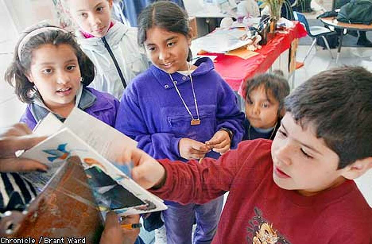 Trevor Lewellen, 6, right, and other San Rafael Canal area children use the Canal Community Alliance daycare facility. The childcare gets funding from the Buck fund...while other programs for needy Marinites are left unfunded. By Brant Ward/Chronicle