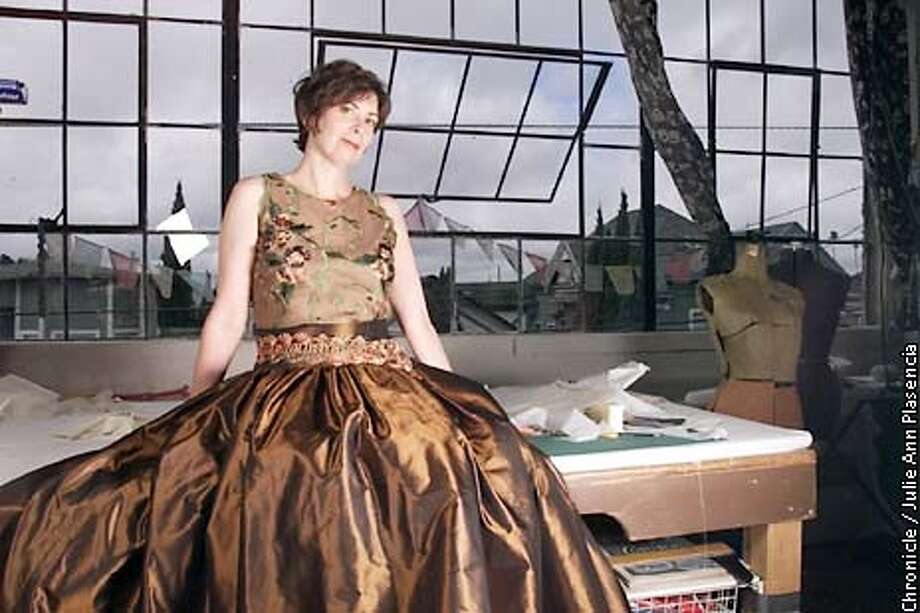 Sylvia Rubin models a copied haute couture outfits that normally costs upwards of $20,000. Outfits were made by local seamstress Sharon Olson of Glad Rags to Gowns. (JULIE PLASENCIA/SFC) Photo: JULIE PLASENCIA