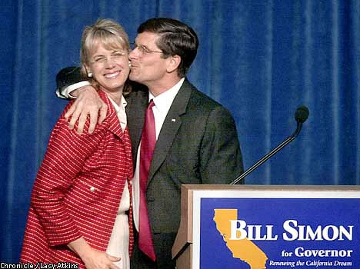 Republican Govenor canidate Bill Simon gives his wife Cindy a kiss as he thanks her for her help in the election at his victory speech. PHOTO BY LACY ATKINS/CHRONICLE