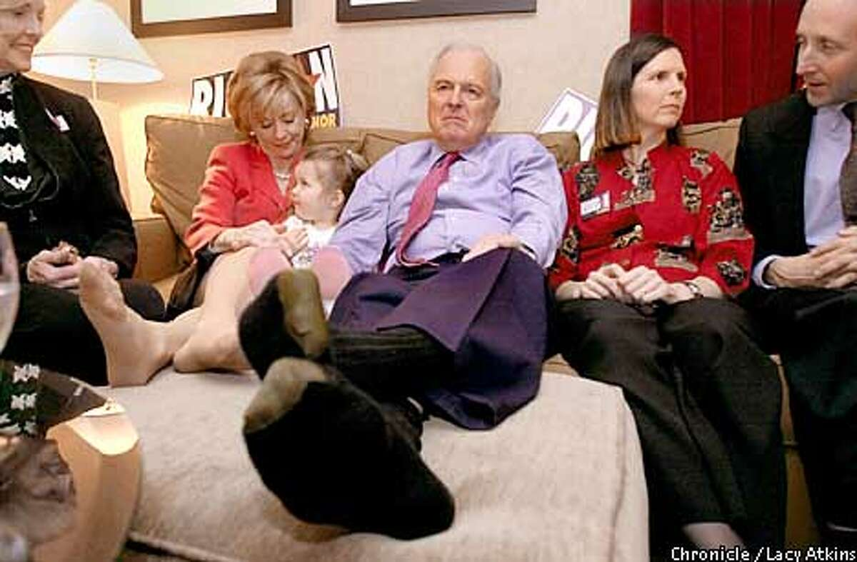 Republican Govenor canidate Richard Riordan(center), sits with his wife Nancy,left holding grandaughter Jessica and daughter Tricia Torrey,right, with husband Dana, in his hotel room at the Airport Westin in Los Angeles, watching the returns come over the television Tuesday March 5,02. PHOTO BY LACY ATKINS/CHRONICLE