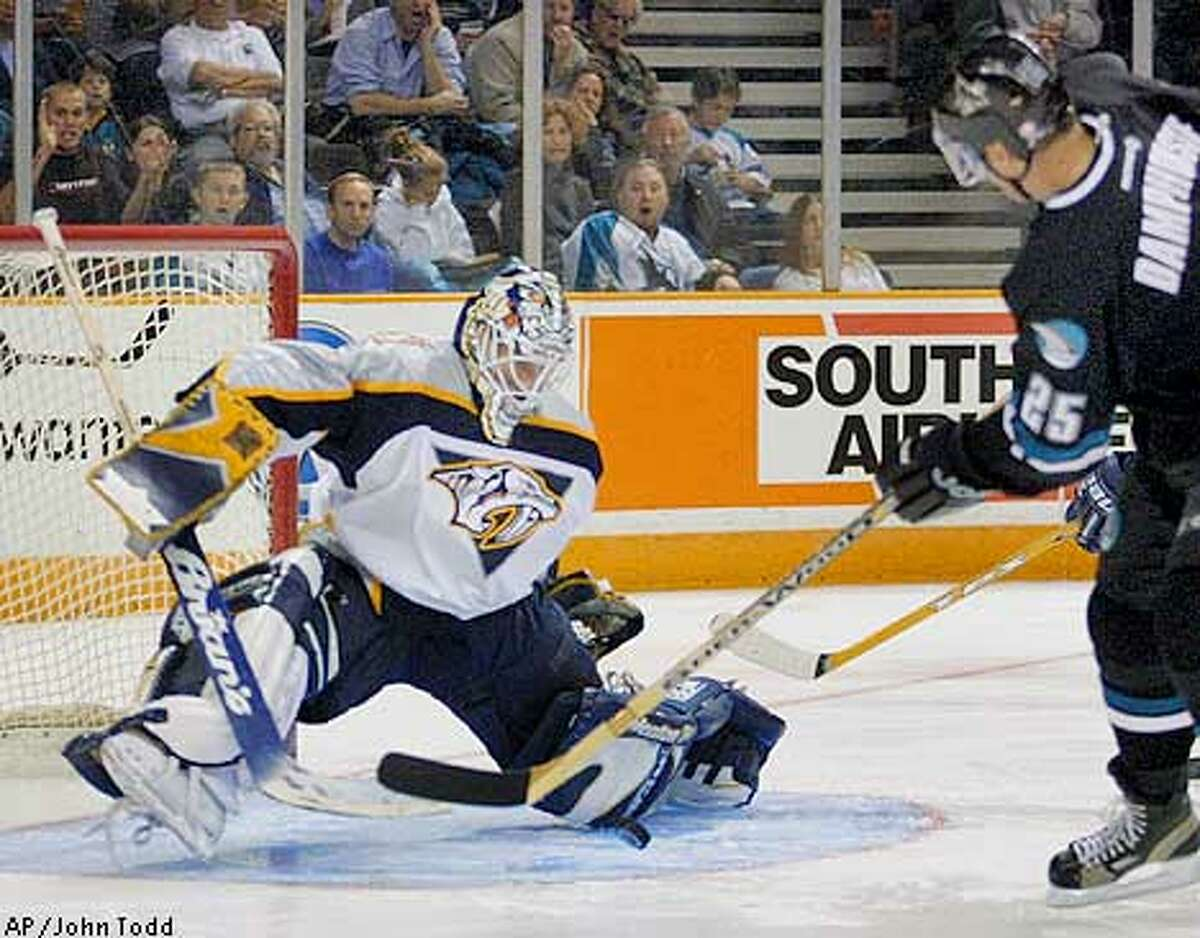 Mike Dunham: Olympic goal tenderClass of 1990 Seen here: Nashville Predators goalie Mike Dunham stops a shot by San Jose Sharks' Vincent Damphousse, right, in the second period in San Jose, Calif., Tuesday, March 5, 2002. (AP Photo/John Todd)