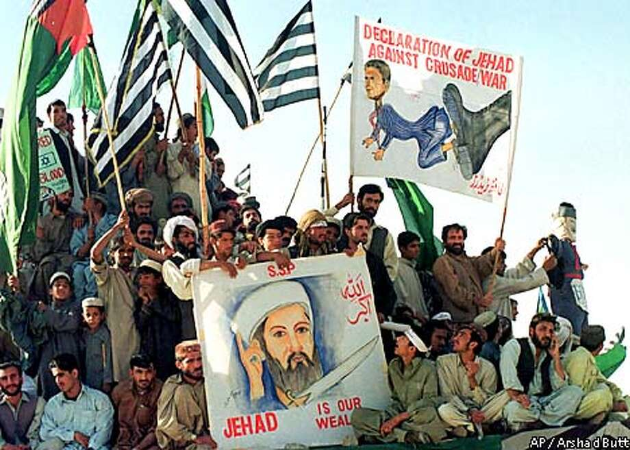 Supporters of Saudi dissident Osama bin Laden attend an anti-U.S. rally on Monday, Oct 15, 2001 in Quetta, Pakistan. (AP Photo/Arshad Butt) Photo: ARSHAD BUTT