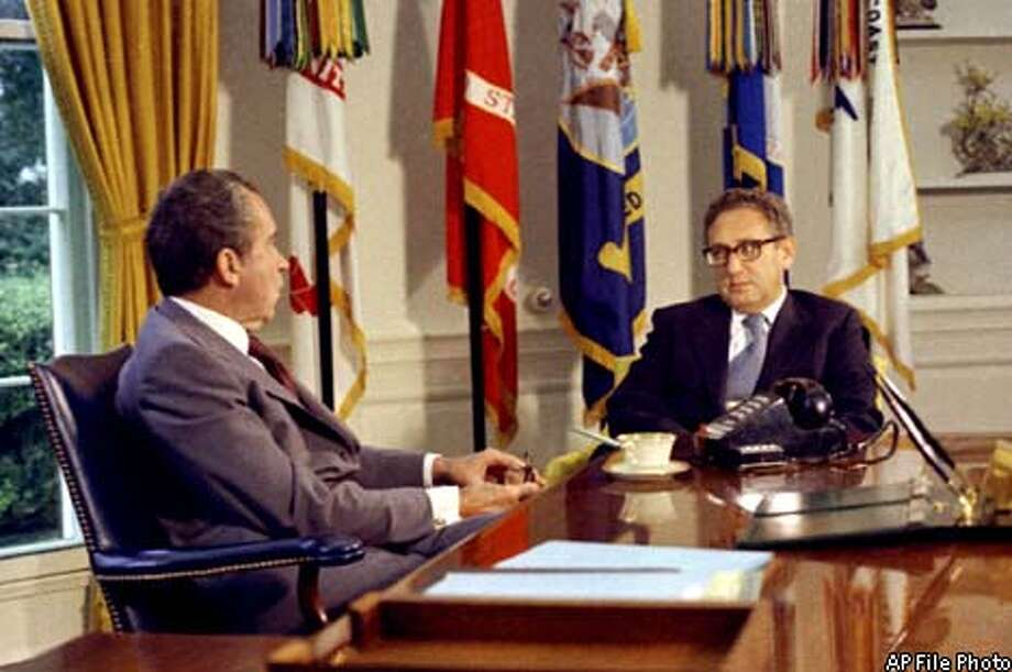Henry Kissinger sat with Richard Nixon in the Oval Office. Kissinger, a national security adviser and secretary of state under Nixon, once quickly played down the president's abrupt suggestion of a nuclear attack on North Vietnam. Associated Press File Photo