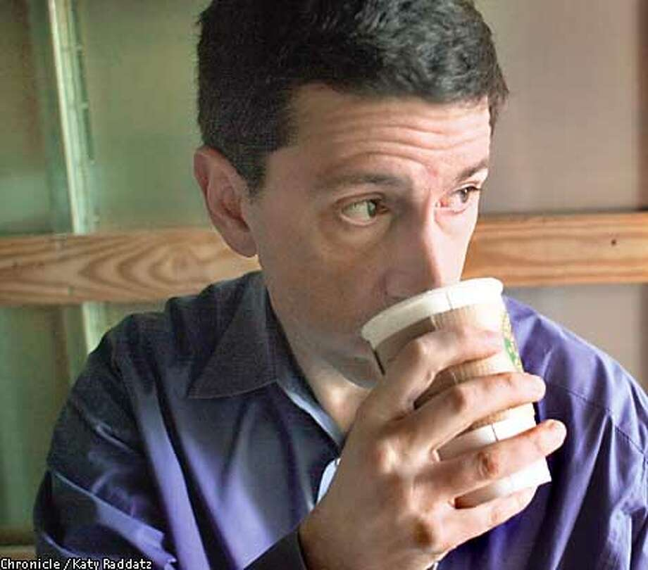Photo by Katy Raddatz--The Chronicle  Story about delivery of gourmet coffee to offices. SHOWN: Tom Steuber (drinking coffee) is the owner of Associated Services, based in Oakland. His company delivers Starbucks coffee as well as other supplies to coffee room machines all over the Bay Area. Photo: KATY RADDATZ