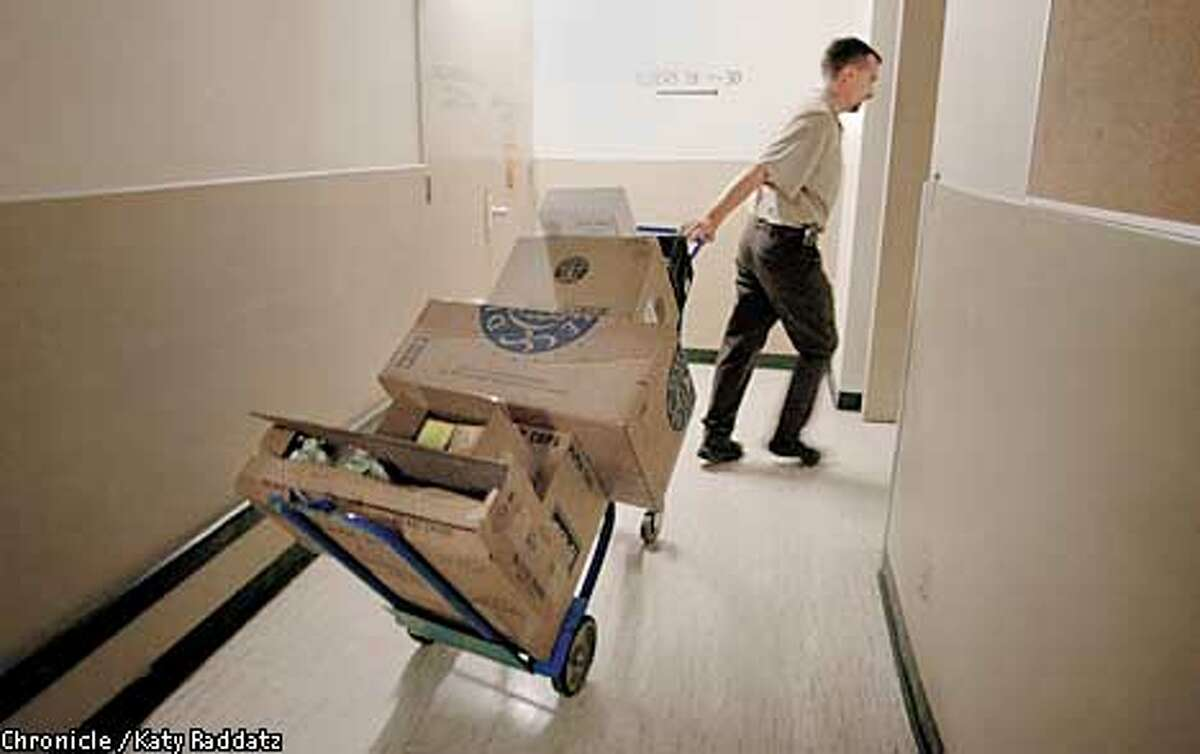 Photo by Katy Raddatz--The Chronicle Story about delivery of gourmet coffee to offices. SHOWN: Delivery guy is Mike Frey, he works for Associated Services (based in Oakland)--Mike is whipping through the maze of halls and freight elevators of 595 Market St. with his delivery.