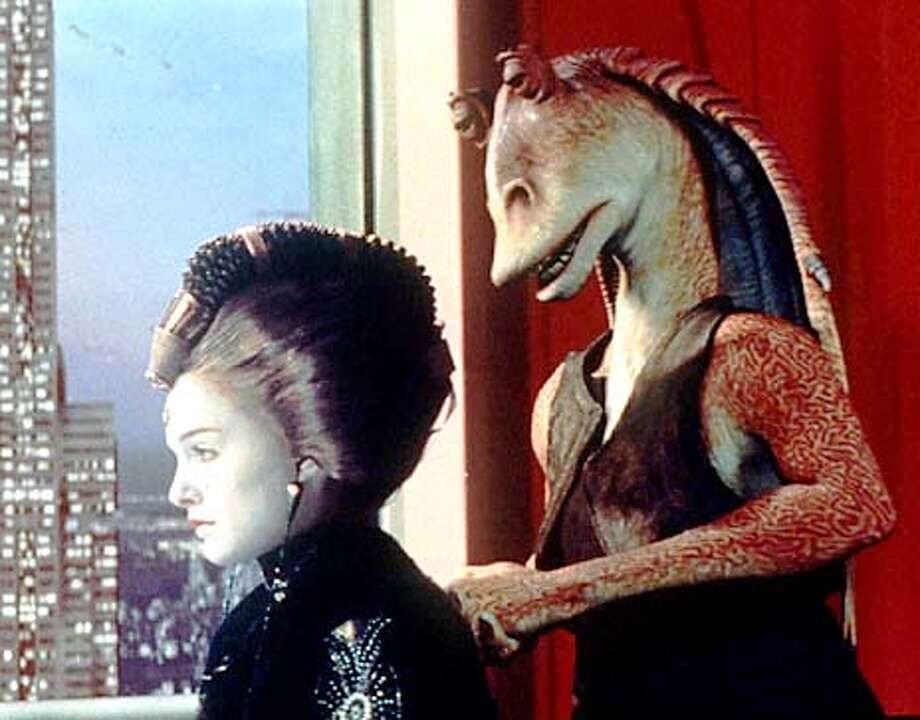 """Queen Amidala, played by Natalie Portman, stares at a cityscape of the galactic capital Coruscant in this scene from """"Star Wars: Episode I The Phantom Menace."""" Jar Jar Binks, right, comforts the queen in the George Lucas film opening May 19, 1999."""
