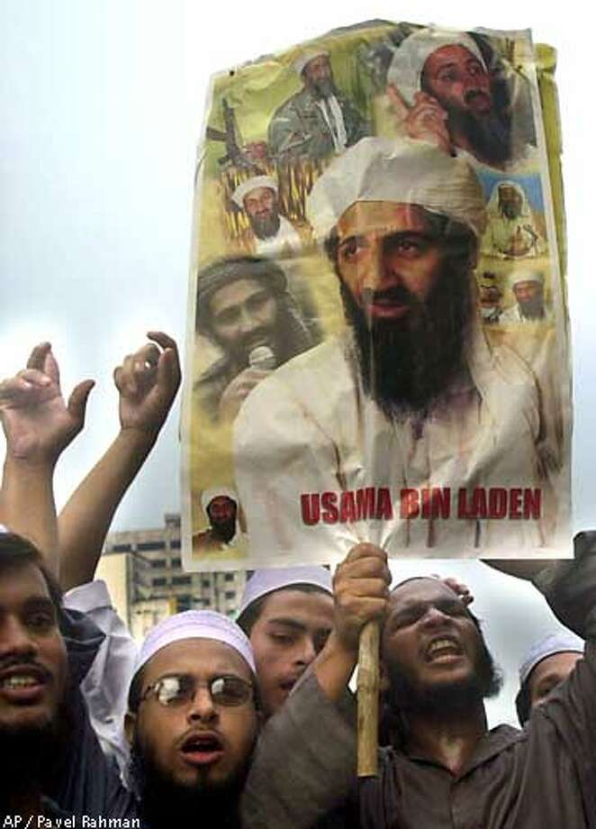 "Demonstrators hold up a poster of terrorist suspect Osama bin Laden during a pro Bin Laden rally in Dhaka, Bangladesh Monday, Oct. 8, 2001. Within the poster, at center right, is a printed image of ""Sesame Street"" children's television character ""Bert."" Azad Products, who manufactures the poster was not aware of the appearance of Bert in one of the collaged images that make up the poster. ``We got the images through e-mails and off the internet. We did not give the pictures a second look or realize what they signified until you pointed it to us,'' Mostafa Kamal, production manager, told The Associated Press. Sesame Street or Bert are hardly known in Bangladesh. (AP Photo/Pavel Rahman) Photo: PAVEL RAHMAN"