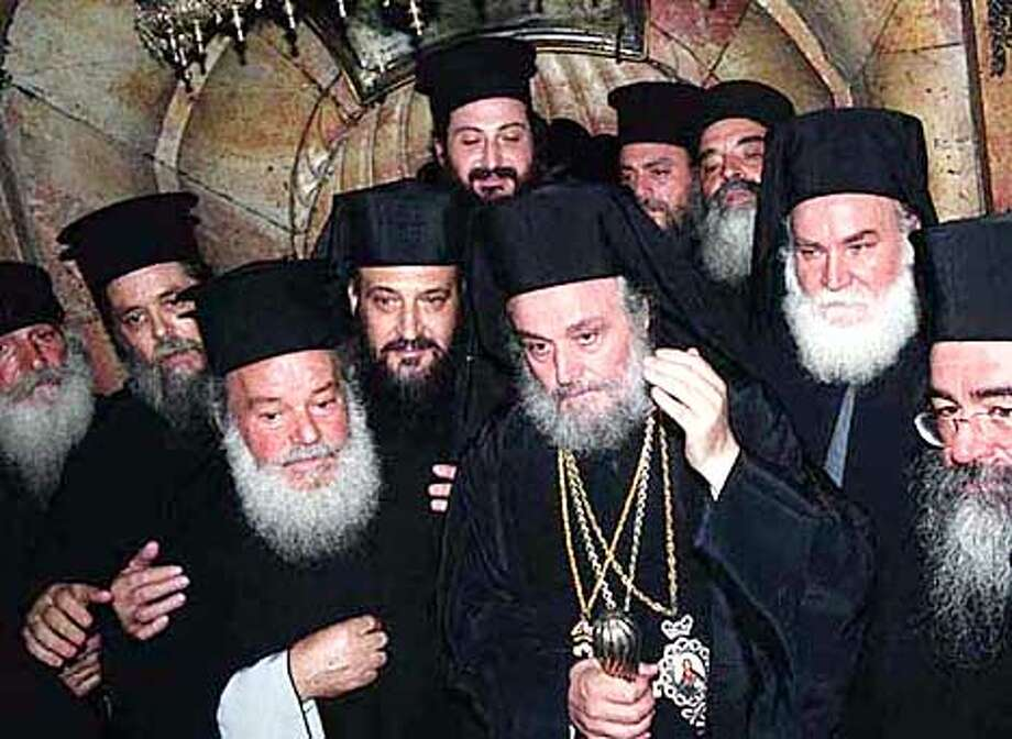 The nomination of Patriarch Irineos I (center, wearing religious jewelry) as leader of the Greek Orthodox Church in the Holy Land was delayed for months by opposition from Israel. Special to the Chronicle