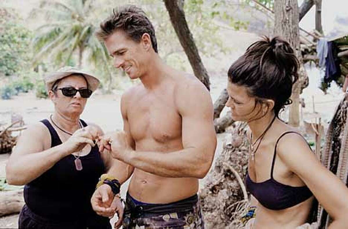 CAPTION: SURVIVOR: MARQUESAS contestants Patricia Jackson, left, Hunter Ellis and Gina Crews in the Maraamu campsite. Photo: David M. Russell/CBS COPYRIGHT: �2002 CBS Worldwide Inc. All Right Reserved. This image may not be sold, distributed, stored or archived by any organization, agency or person. This image is for editorial use only, in North America only (United States of America, Canada, Mexico and Caribbean Islands). Editorial publication is not permitted after June 30, 2002. For usage of this image outside the above terms and conditions, please contact CBS via email at: cbsphotoarchive@cbs.com or via fax at 212/975-3338.