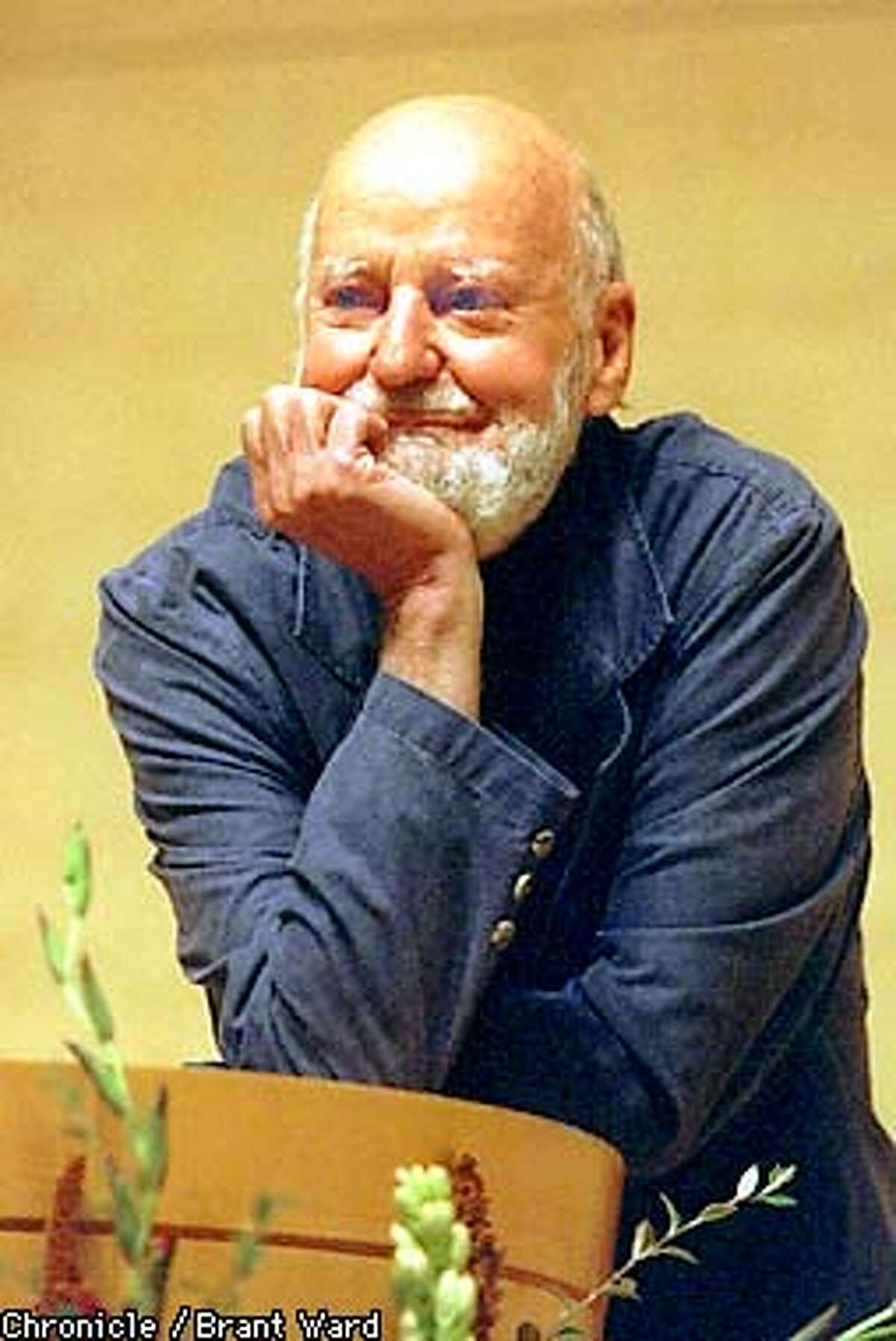 FERLINGHETTI/13OCT98/MN/BW--The new San Francisco poet laureate Lawrence Ferlinghetti politely listened to a heckler interrupt his poetry readings Tuesday night at the main Library. By Brant Ward/Chronicle. Also ran 10/28/2000.