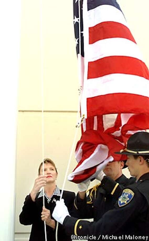 Deena Burnett raises a flag in honor of her late husband Tom Burnett, Jr. The flagpole and plaque were dedicated in a ceremony.  A dedication ceremony for Flight 93 hero Tom Burnett, Jr was held at his former workplace, Thoratec Corporation in Pleasanton. Burnett's wife Deena Burnett and parents Thomasand Beverly Burnett Sr were in attendence.  CHRONICLE PHOTO BY MICHAEL MALONEY Photo: MICHAEL MALONEY