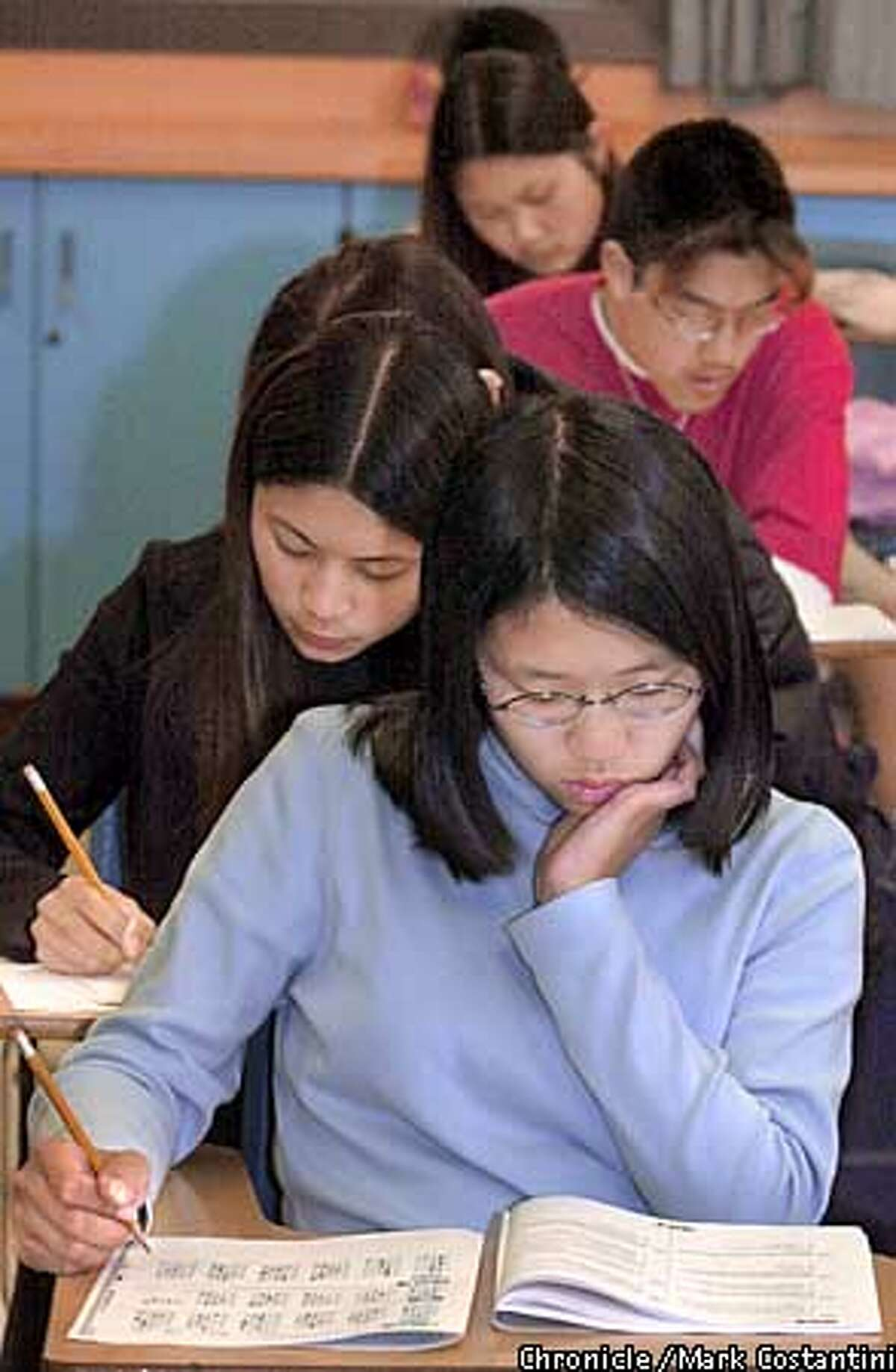 In this file photo, Johanna Lee(front) and other students at Alameda High School in Alameda take standardized tests.