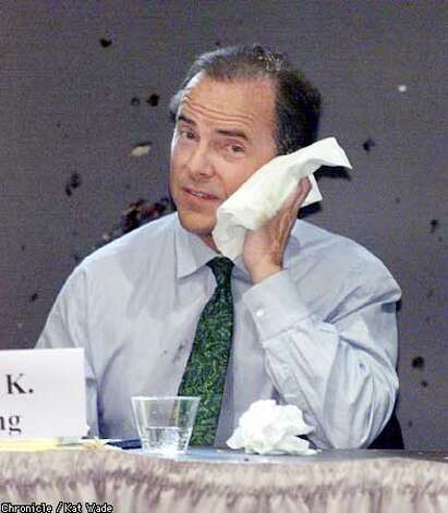 Enron chief executive, Jeff Skilling wipes pie off of his face after a woman pied the executive before his speach at the Common Wealth Club about recent regulatory decisions over California's energy crisis. SAN FRANCISCO CHRONICLE PHOTO BY KAT WAD.E Photo: KAT WADE