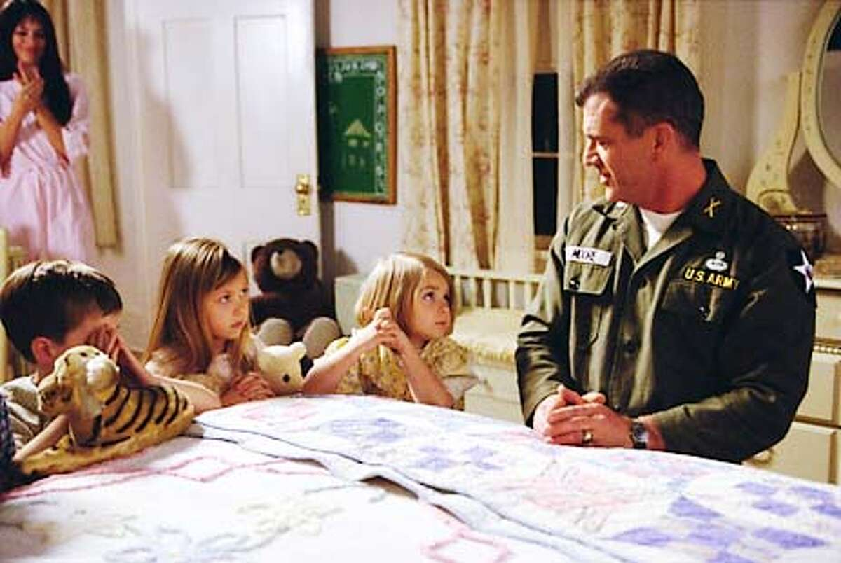 WWS-4482 Photo by Stephen Vaughan (Left to right) Madeleine Stowe as Julie Moore, Luke Benward as David Moore, Taylor Momsen as Julie Moore, Sloane Momsen as Cecile Moore and Mel Gibson as Lieutenant Colonel Harold G. Moore in 'We Were Soldiers.' 'We Were Soldiers' is a Paramount Pictures and an Icon Productions Presentation. An Icon/Wheelhouse Entertainment Production. Written for the screen and directed by Randall Wallace, the film stars Mel Gibson, Madeleine Stowe, Greg Kinnear, Sam Elliott, Chris Klein, Keri Russell and Barry Pepper. The film is produced by Bruce Davey, Stephen McEveety and Randall Wallace. Jim Lemley and Arne L. Schmidt serve as executive producers. The co-producers are Danielle Lemmon and Stephen Zapotoczny. Paramount Pictures is part of the entertainment operations of Viacom Inc., one of the world�s largest entertainment media companies and a leader in the production, promotion and distribution of entertainment, news, sports and music. This film is rated R by the Motion Picture Association of America for sustained sequences of graphic war violence and language. (HANDOUT PHOTO)