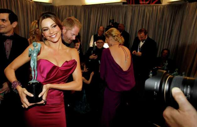 "Sofia Vergara is seen backstage with the award for outstanding performance by an ensemble in a comedy series for ""Modern Family"" at the 18th Annual Screen Actors Guild Awards on Sunday Jan. 29, 2012 in Los Angeles. Photo: AP"