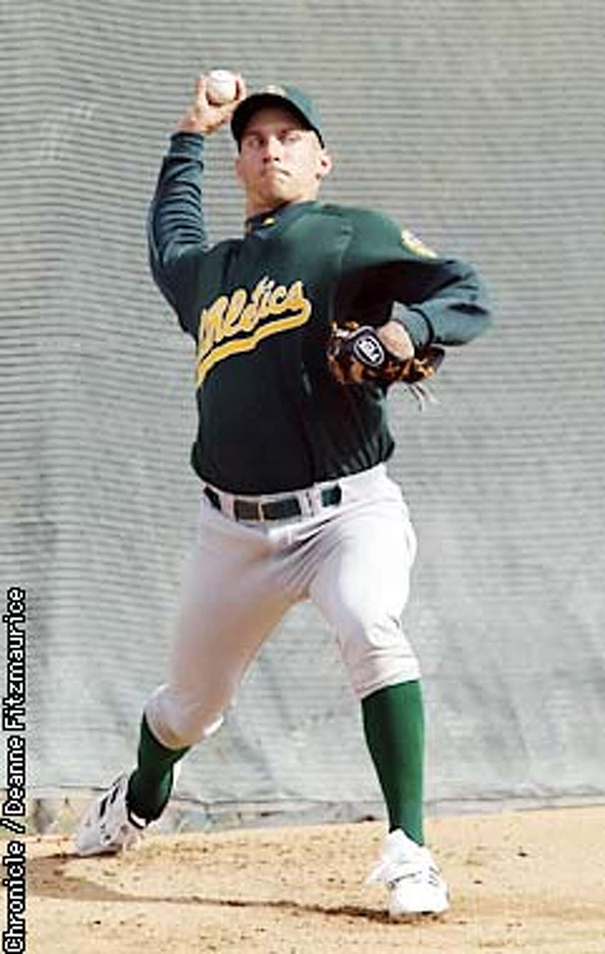 Oakland Athletics new pitcher Billy Koch throws pitches at A's Spring Training in Phoenix, AZ. CHRONICLE PHOTO BY DEANNE FITZMAURICE