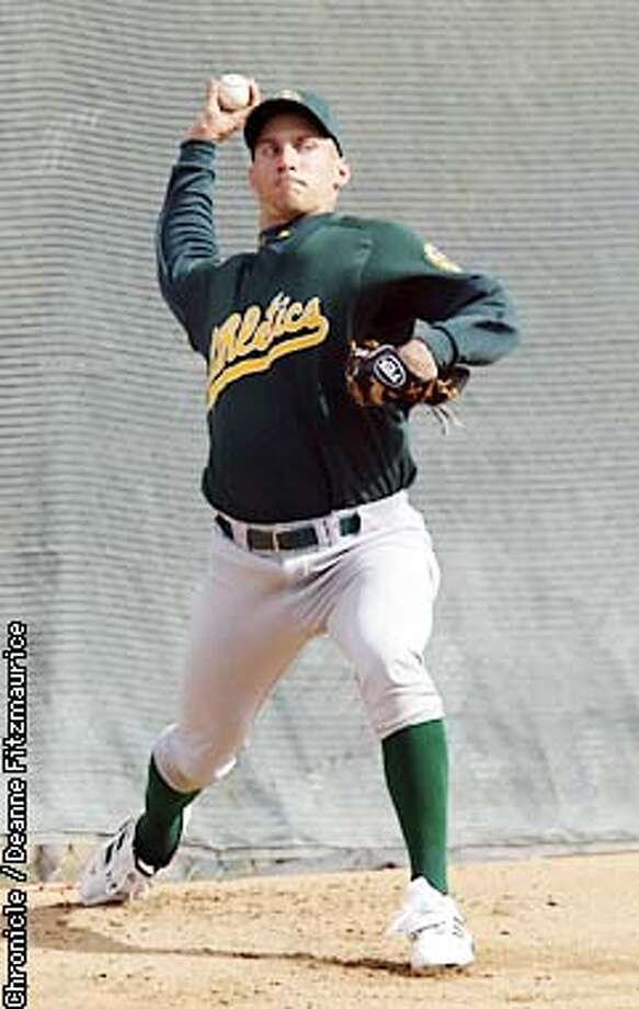Oakland Athletics new pitcher Billy Koch throws pitches at A's Spring Training in Phoenix, AZ.  CHRONICLE PHOTO BY DEANNE FITZMAURICE Photo: DEANNE FITZMAURICE