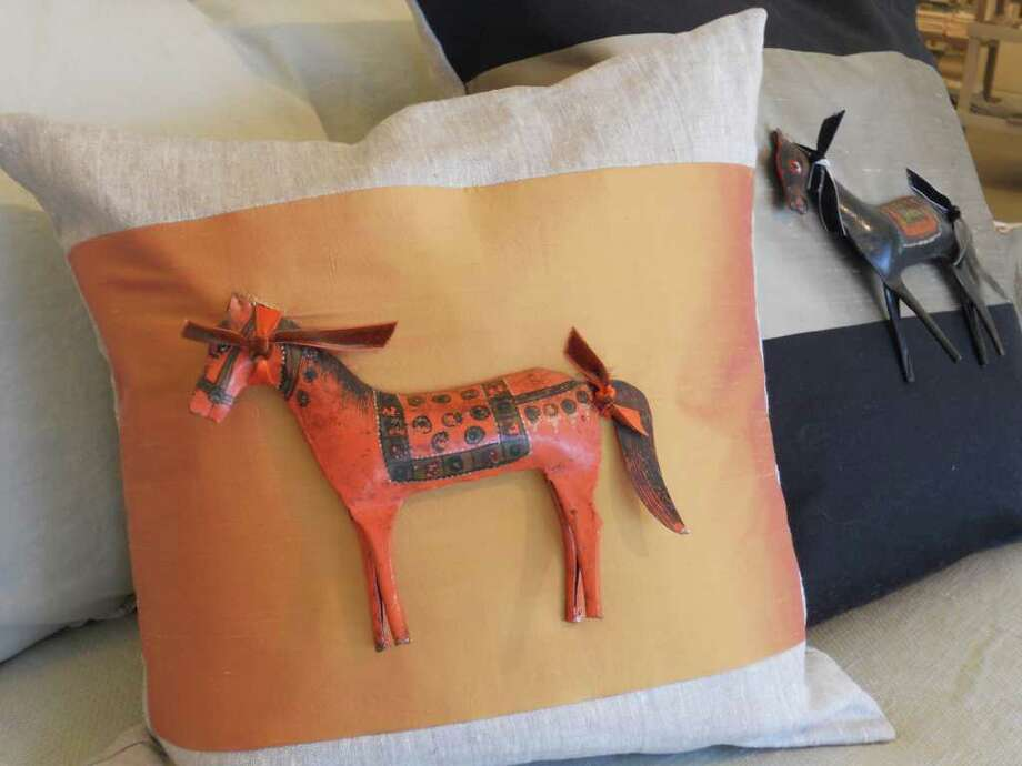 4307 McCullough Ave.: Lin Marche's antique horse on silk pillows (from left) 18 inch pillow, $315 and 24 inch pillow, $475. Photo: Jennifer Rodriguez/Special To The Express-News