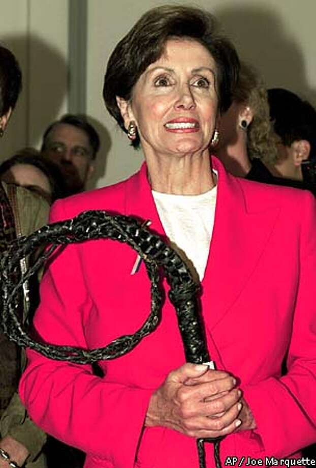 Just elected House Minority Whip Nancy Pelosi D-Calif., holds a whip she got from outgoing House Minority Leader Rep. David Bonior, D-Mich,, Wednesday Oct. 10,2001 in Washington. Pelosi defeated Rep. Stenny Hoyer, D-Md. for the Democratic whip post in the House of Representatives. (AP Photo/Joe Marquette) Photo: JOE MARQUETTE