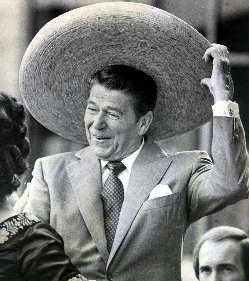 A reader who objects to Arizona Gov. Jan Brewer's dressing down of President Obama cites a 1983 visit by President Reagan to San Antonio, where he was graciously welcomed by then-Mayor Henry Cisneros. Here Reagan dons a sombrero in 1980 while campaigning in San Antonio. Photo: San Antonio Express-News, File Photo / SAN ANTONIO EXPRESS-NEWS