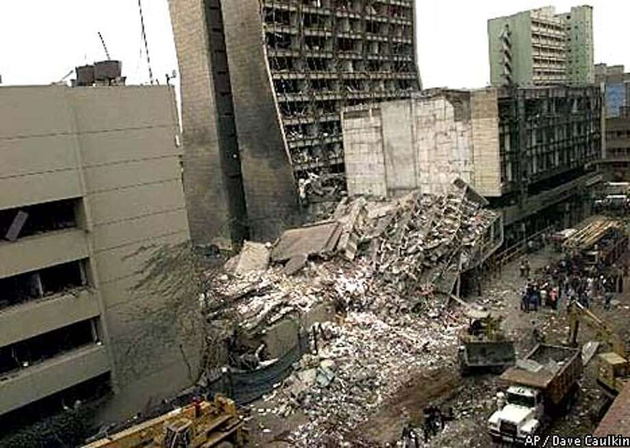FILE--The United States Embassy, left, is pictured with blasted ruins next to it in downtown Nairobi, Kenya Saturday, Aug. 8, 1998 the day after terrorist bombs in Kenya and Dar es Salaam, Tanzania. U.S. President Bill Clinton said Thursday Aug. 20, 1998, that he ordered military strikes against terrorist facilities in Afghanistan and Sudan in retaliation for two recent embassy bombings in Africa. (AP Photo/Dave Caulkin)(AP Photo/Dave Caulkin)