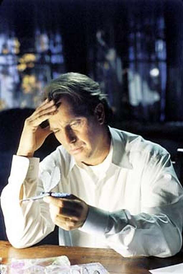 Dr. Joe Darrow (Kevin Costner) believes that his deceased wife may be trying to communicate with him. Photo: HANDOUT