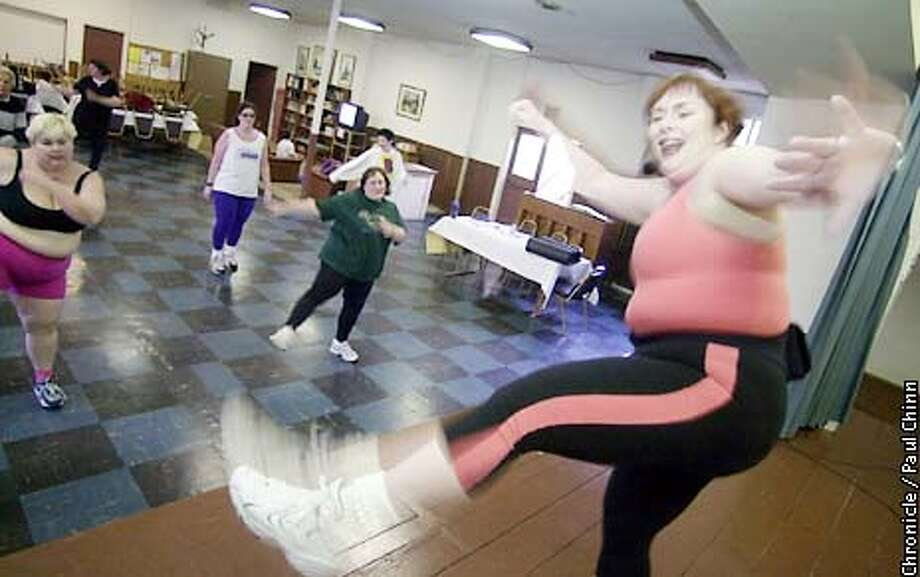 Jennifer Portnick (right) taught her weekly aerobics class Saturday morning at Miraloma Church.  PAUL CHINN/S.F. CHRONICLE Photo: PAUL CHINN