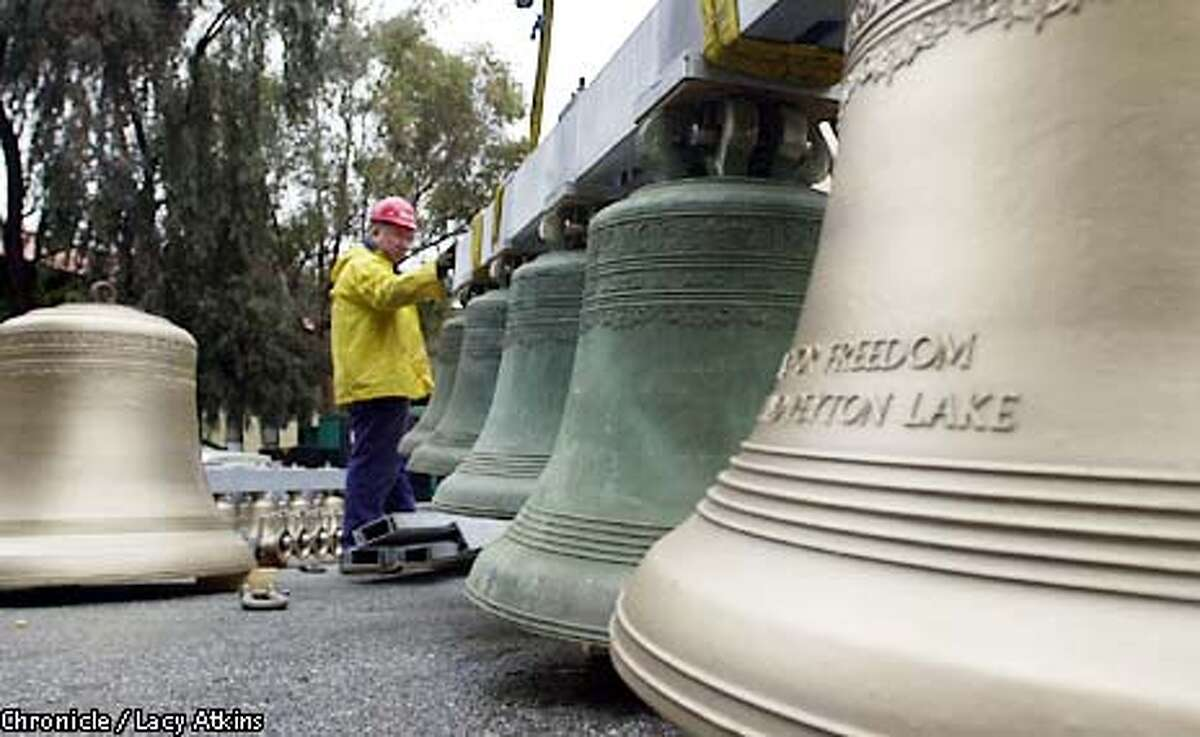 Greg Diener stablizes the Hoover bells as they are lifted to go back into the Hovver Tower, Tuesday Feb.19,02, in Stanford. the sixty year old bells are being replaced after be restored in Belgium. PHOTO BY LACY ATKINS/SAN FRANCISCO CHRONICLE