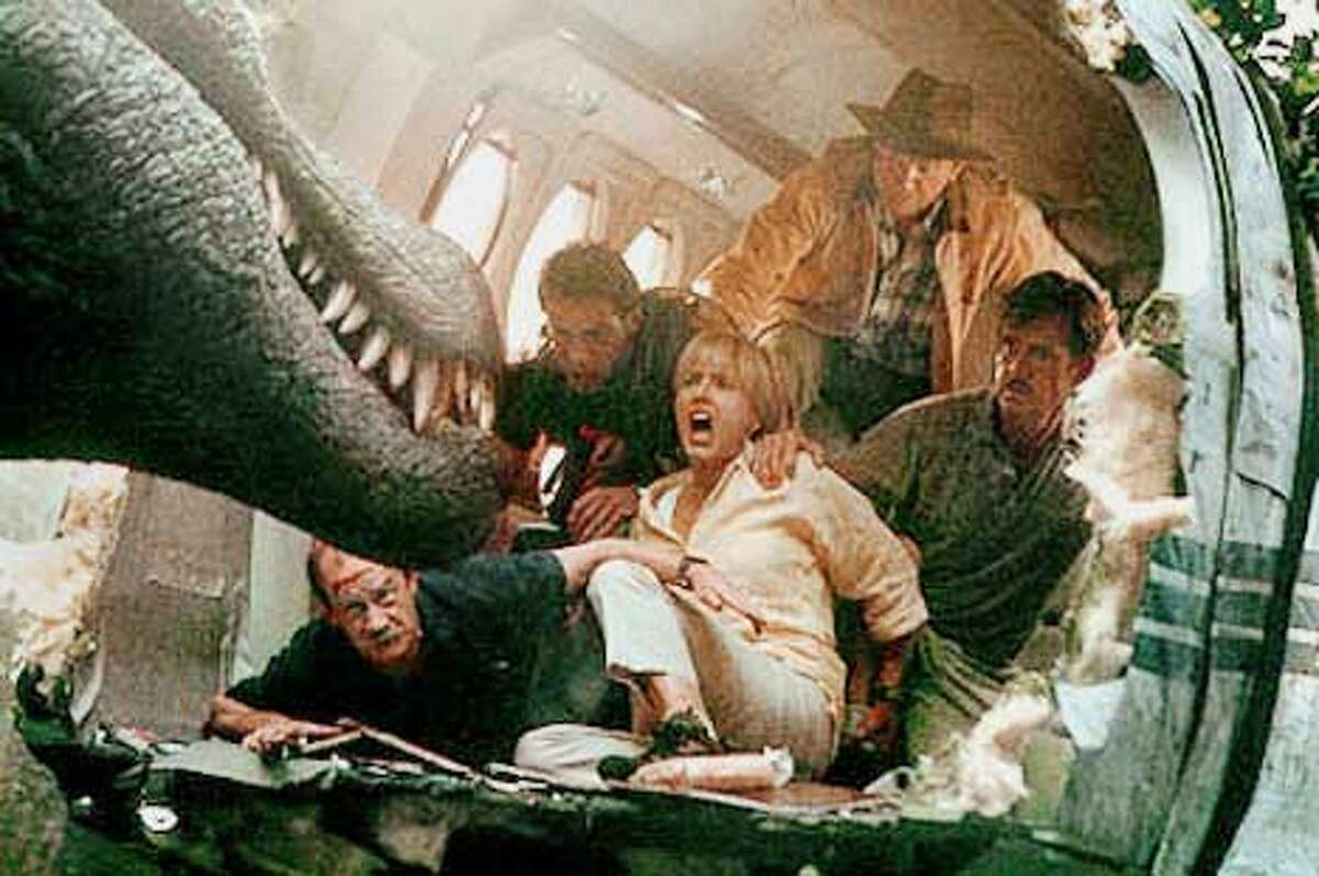 """Clockwise from top: Sam Neill, William H. Macy, Tea Leoni, Michael Jeter and Alessandro Nivola face the enemy in """"Jurassic Park III"""""""