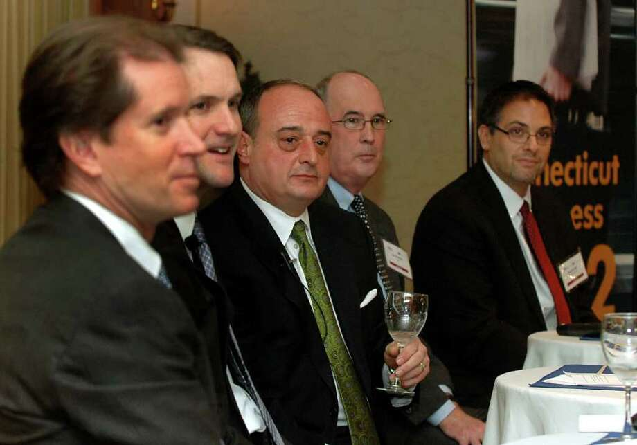 State Sen. L. Scott Frantz,  U.S. Rep. Jim Himes, State Rep. Larry Cafero,  Joe Brennan, senior VP of public policy at CBIA and David Lewis, president and CEO of Operations Inc., participate in a panel discussion on business and state policies held at the Norwalk Inn & Conference Center in Norwalk, Conn. on Tuesday, Jan 31, 2012. Photo: Cathy Zuraw / Stamford Advocate