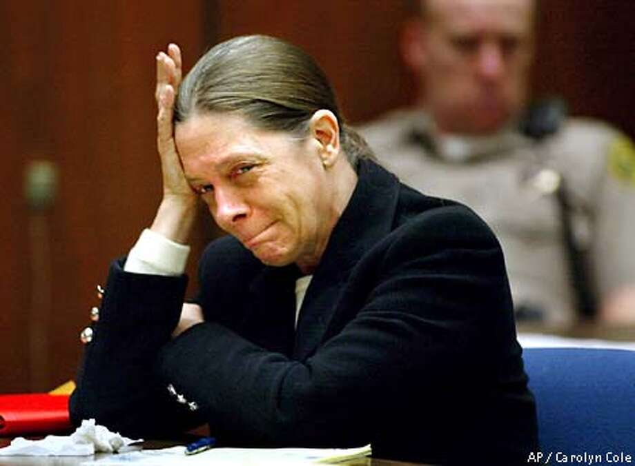 Marjorie Knoller weeps as her attorney Nedra Ruiz describes the events of the death of Diane Whipple, in a Los Angeles court Tuesday, Feb. 19, 2002. Whipple died in San Francisco Jan. 26, 2001, from wounds caused by Knoller's dogs. Knoller and her husband face manslaughter and other charges for Whipple's fatal mauling. (AP Photo/Carolyn Cole, Pool) Photo: CAROLYN COLE
