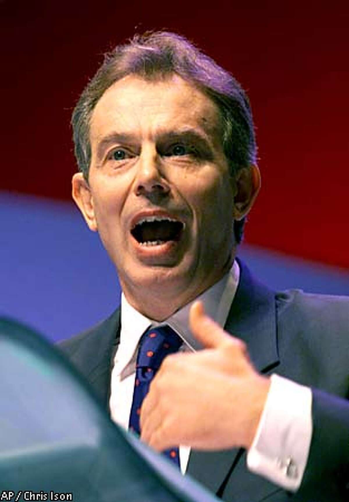 Britain's Prime Minister Tony Blair takes the stage to give his keynote speech at the Labour Party annual conference, in Brighton, England, Tuesday, Oct. 2, 2001. Blair warned Afghanistan's Taliban regime, during his speech, to surrender Osama bin Laden and his supporters or face being forced out of power. (AP Photo/Chris Ison/PA) UNITED KINGDOM OUT: MAGAZINES OUT: :