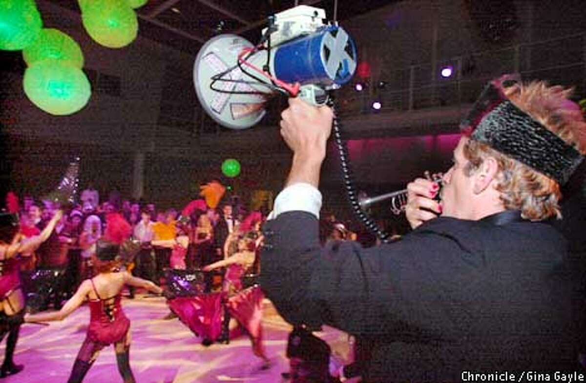 Bandmember Scorch uses a bullhorn to get the crowd going while the Extra Action Marching Band played the Artists Ball at the Yerba Buena Center for the Arts. Photo by Gina Gayle/The SF Chronicle.