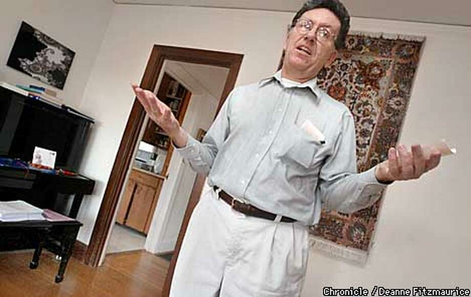 Bob Uomini won a 22 million lottery in 1995. He is holding a lottery ticket which he bought last week which won $54 with 4 correct numbers. He is in the living room of his Berkeley home.  CHRONICLE PHOTO BY DEANNE FITZMAURICE Photo: DEANNE FITZMAURICE