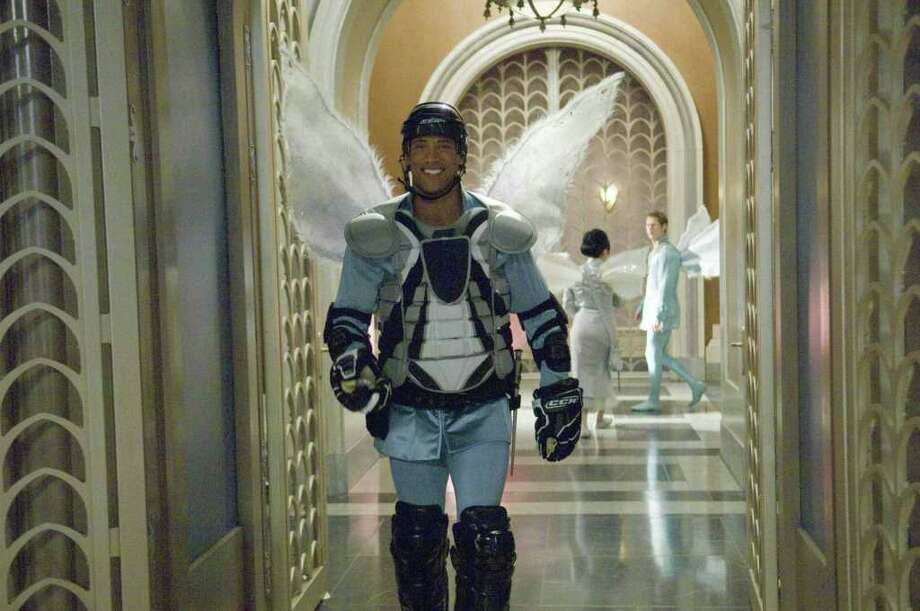 "Dwayne Johnson donned wings for his role in ""The Tooth Fairy."" Photo: 20th Century Fox / © 2009 Twentieth Century Fox, LLC and Walden Media, LLC. All Rights Reserved."