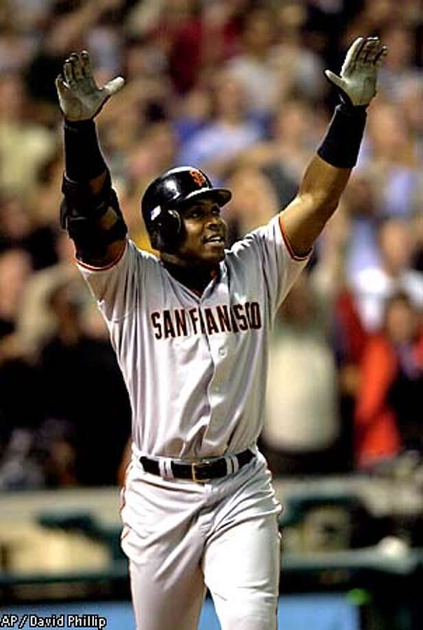 San Francisco Giants' Barry Bonds raises his hands after hitting his 70th home run of the season during the ninth inning against the Houston Astros Thursday, Oct. 4, 2001 in Houston. Bonds tied the record held by Mark McGwire. (AP Photo/David Phillip) Photo: DAVID PHILLIP