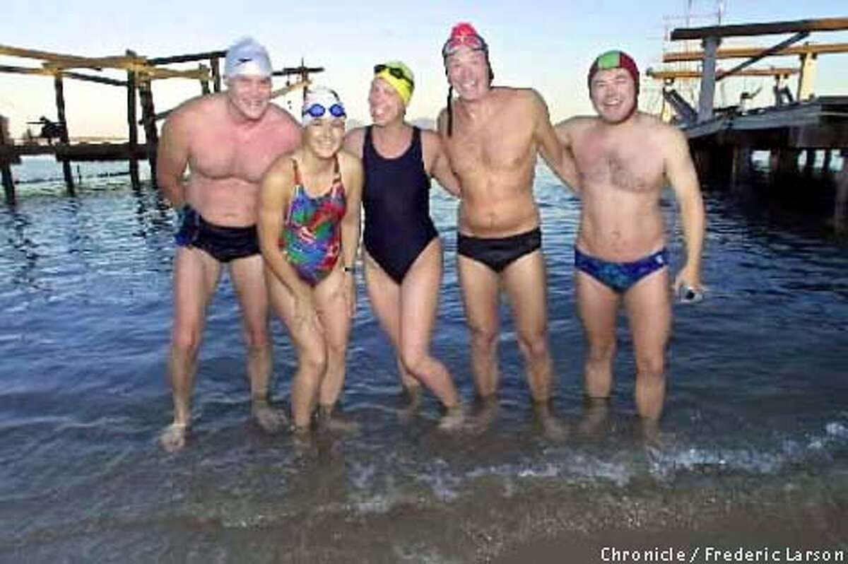 BIGSWIM04-C-26SEP01-SP-FRL: (L-R) Drew Downs, Kristine Buckley, Colleen Vojvodich, Gary Emich and Dan Needham are six pals of the South End Rowing Club at Aquatic Park SF, that are going to band together to do first-ever swim across Monterey Bay (25 miles, from Santa Cruz to Monterey) in relay. Chronicle photo by Frederic Larson