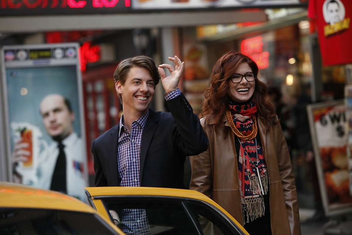 In this image released by NBC, Christian Borle portrays Tom Levitt, left, and Debra Messing portrays Julia Houston in the new series