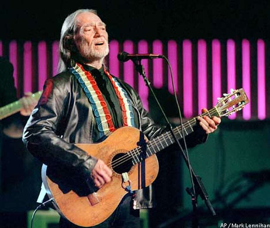 """Willie Nelson performs """"I Still Miss Someone"""" at Hammerstein Ballroom Tuesday, April 6, 1999 in New York during a taping of """"An All-Star Tribute to Johnny Cash"""". The prograpn is scheduled to air Sunday, April 18 on Turner Network television. (AP Photo/Mark Lennihan) Photo: MARK LENNIHAN"""