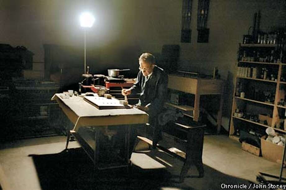 Reed Organ Man James Tyler at work refurbishing parts. Chronicle photo by John Storey