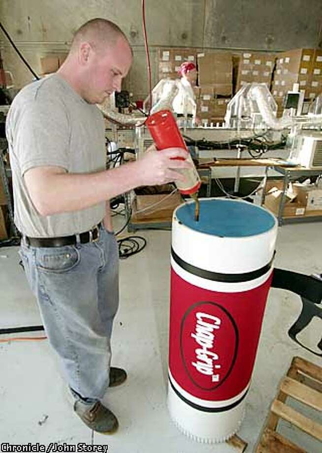 "CHAPGRIP-C-07FEB02-MN-JRS-Jory Francis of the Chap-Grip lip balm company puts the final touches on the ""World's Largest Lip Balm"" at their offices in Kaysville, Utah. Chronicle Photo by John Storey. Photo: John Storey"